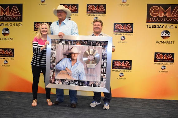 UMGN's Cindy Mabe and Tom Becci honor Alan Jackson's 25 years in music backstage at LP Field.