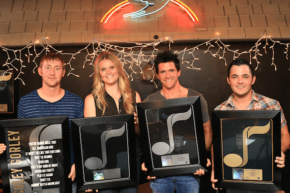 Pictured (L-R): Ashley Gorley, Nicolle Galyon, Michael Carter, Cole Taylor with their NMPA Songwriting Gold & Platinum Awards at the Bluebird Cafe.
