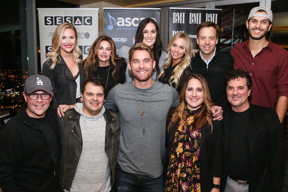 (L-R): Back Row – BMLG Records' Leah Fisher, Angie Coonrod, Lauren Longbine, Liz Gregg Santana, Matthew Hargis, Andrew Thoen. Front Row – BMLG Records President Jimmy Harnen, Justin Ebach, Brett Young, Kelly Archer, BMLG President & CEO Scott Borchetta. Photo: Terry Wyatt