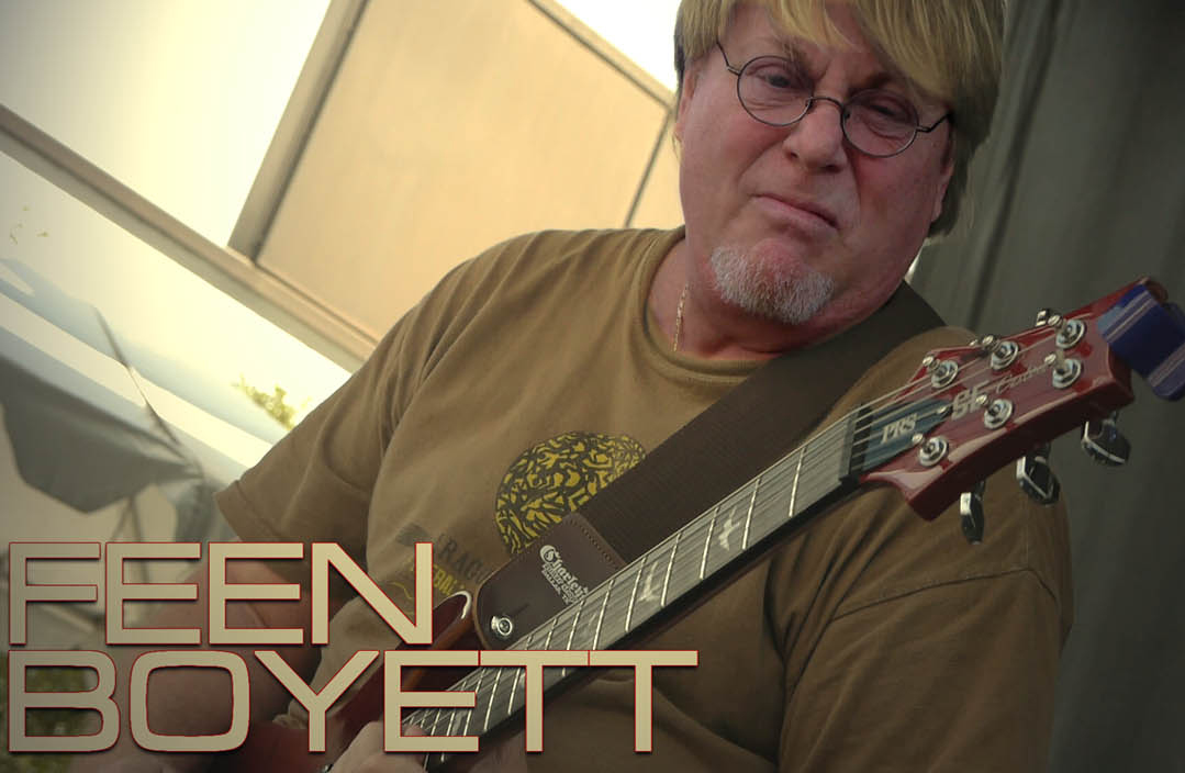 Feen Boyett - Brady with red guitar