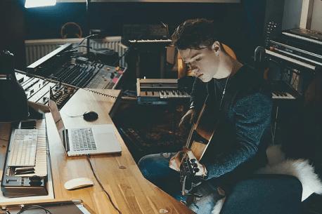 Man Playing Guitar in Studio