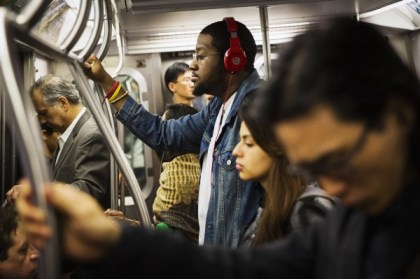 Listening to music on the metro