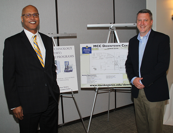 MCC President Dale K. Nesbary and CWC Textron Director of Operations Erik Jepsen review plans for the Downtown Center renovation.