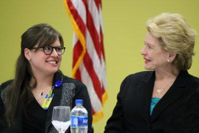 U.S. Senator Debbie Stabenow (D-MI) talks with Eli Fox, the MCC Manager of Student Success and Veterans Affairs, on the MCC campus April 5.