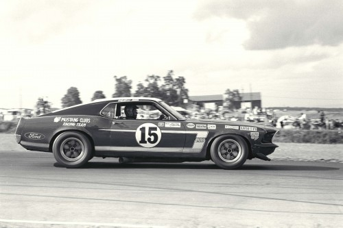 Watkins Glen Trans Am, Watkins Glen, NY, 1969. Bud Moore/Parnelli Jones Mustang in action.  CD#0777-3292-0894-6.