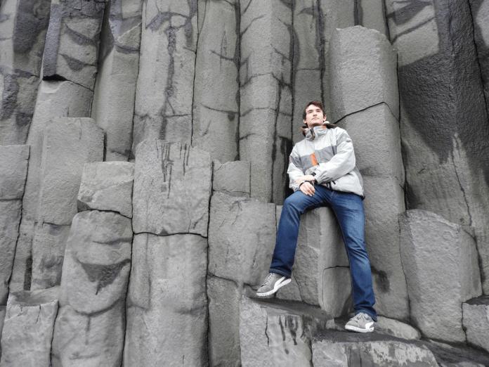 Conor striking a pose on the basalt columns at Reynisfjara black sand beach.