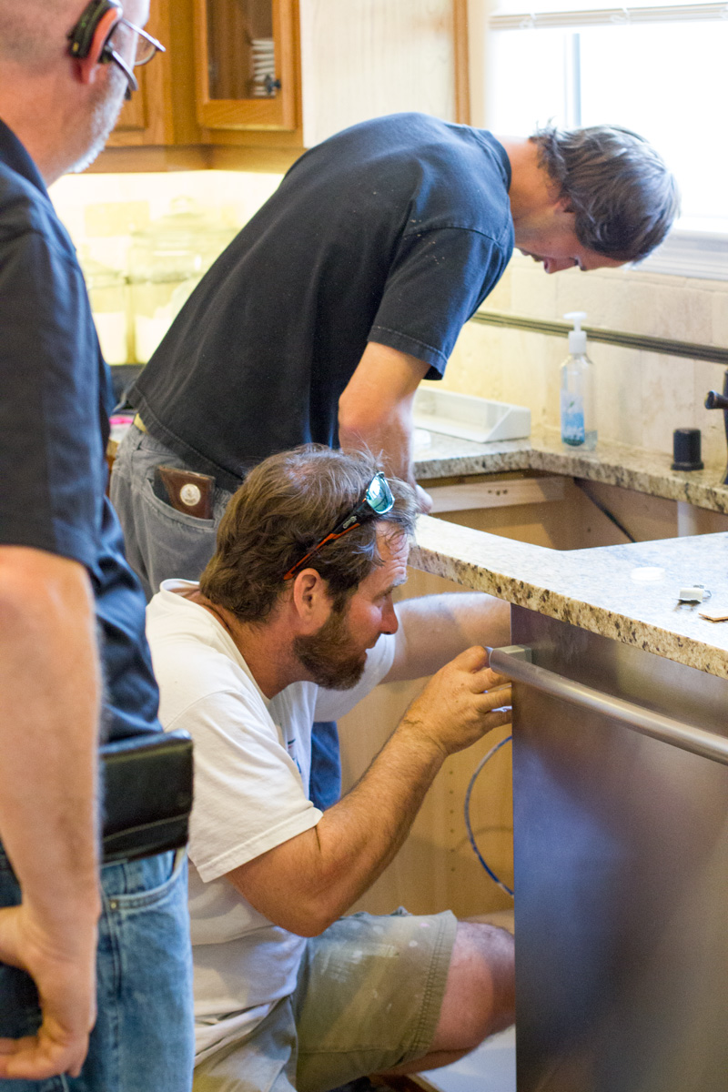 Workers prepping the sink support