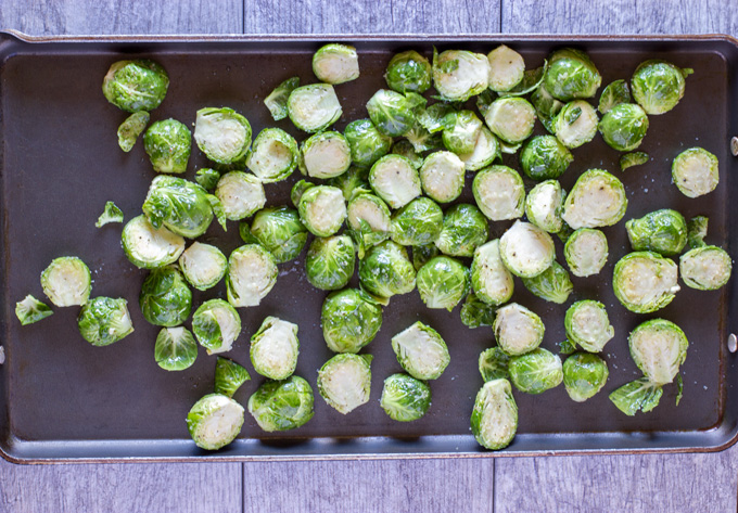 Brussels sprouts seasoned and in the pan