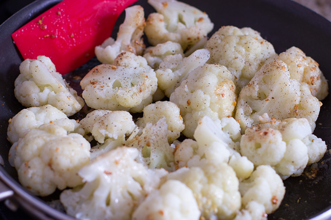 Toss the cauliflower in the butter and toasted garlic