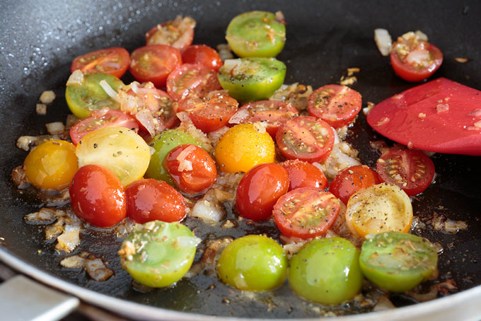 Warm tomato salad in the cooking pan