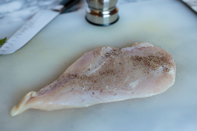 Season the outside layer of the chicken with salt and pepper