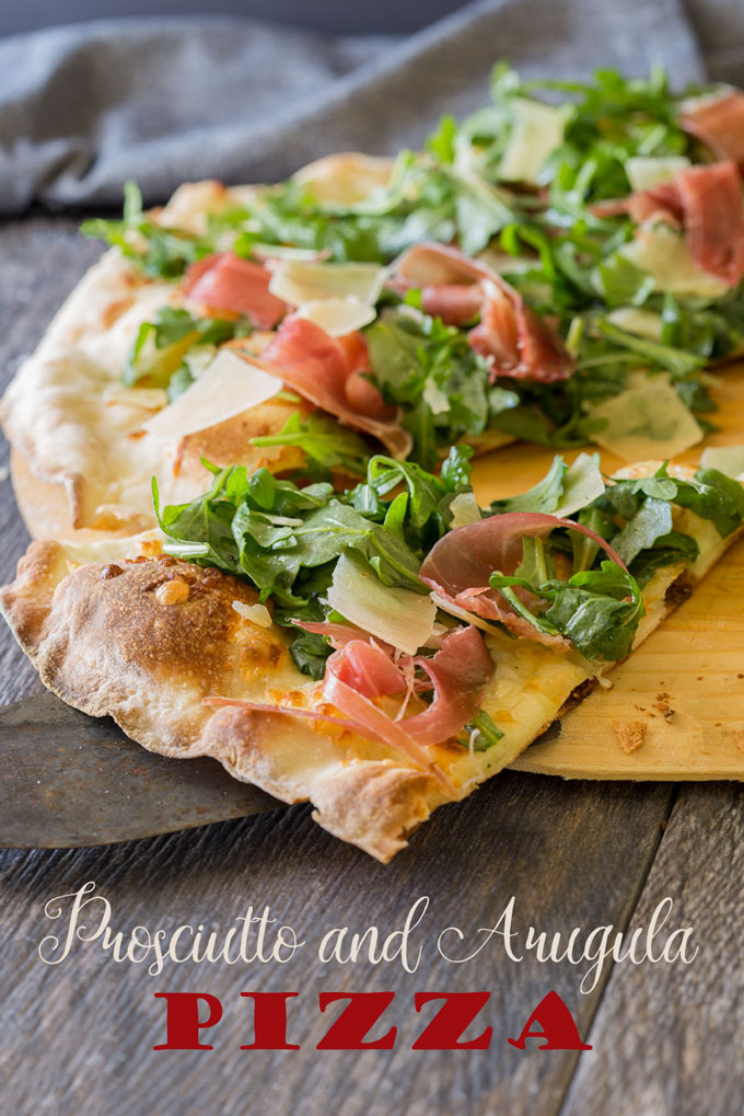 Prosciutto and arugula pizza, sliced with text banner