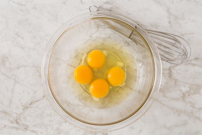 Cracked eggs in a bowl