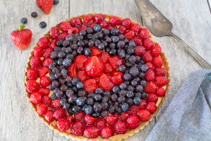 Triple berry cream tart on a table