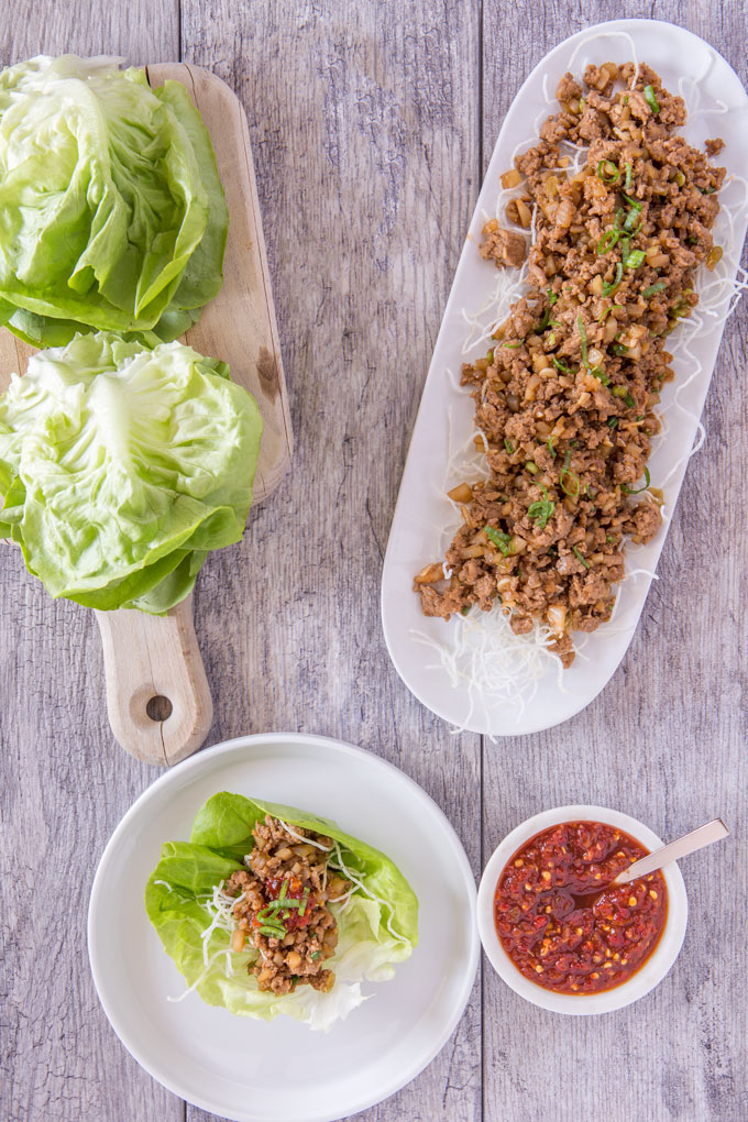 Fixings for turkey lettuce wraps on a table