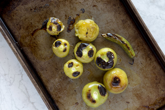 Broiled tomatillos and serrano pepper