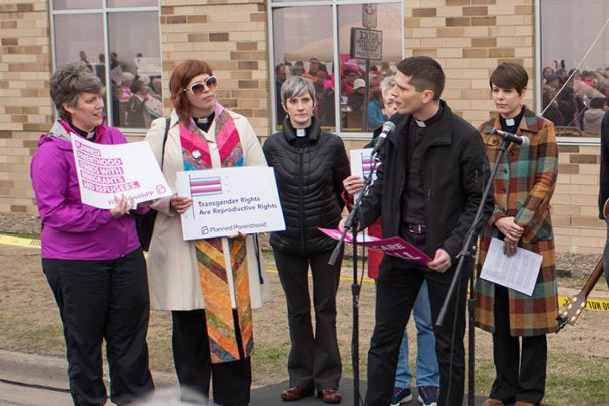 Clergy with signs speaking out in support of reproductive rights at Planned Parenthood's Good Friday rally (2017)