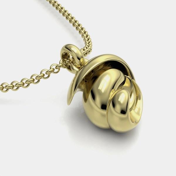Colgante y joya artesanal en oro del compositor Beethoven sobre la obra Fur Elise.