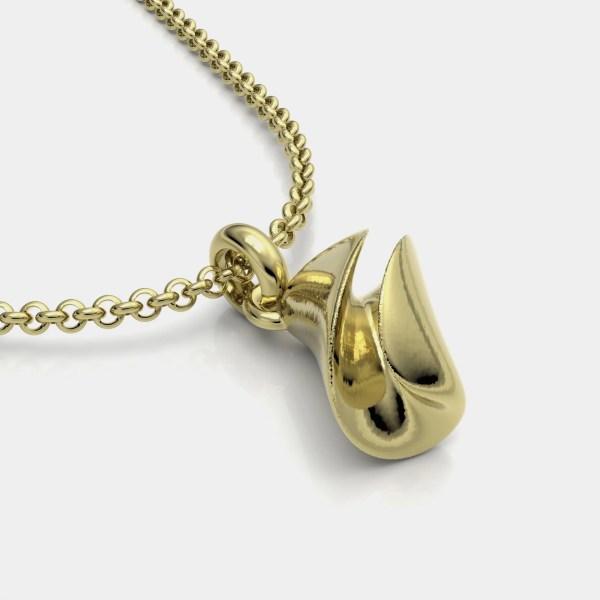Colgante y joya artesanal en oro del compositor Mozart sobre la obra Las bodas de figaro.