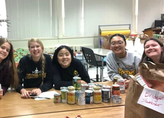 Fall food drives closes with over 600 collected cans