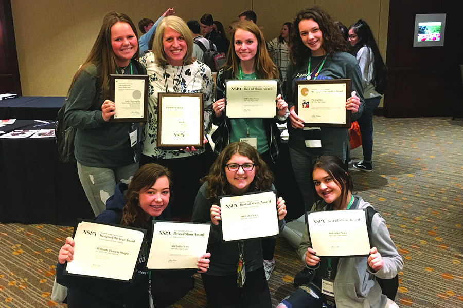 Students who attended the JEA/NSPA National Scholastic Press Association High School Journalism Convention awards ceremony Nov. 17. Six students represented Mill Valley at the convention, attending learning sessions and publications critiques. Their adviser is Kathy Habiger.