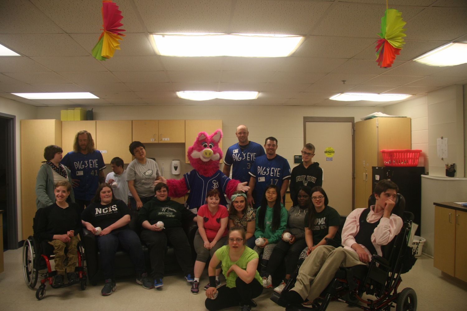 Saints players and mascot visit special education class.