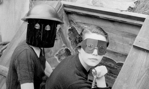 Fire masks become strange creatures in Miller's lens.