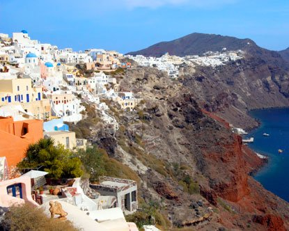 The city is built on a cliff, the edge of the crater formed by a volcanic explosion.