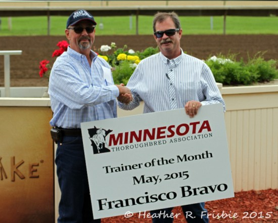 Francisco Bravo (L) accepts the congratulations of MTA President Jay Dailey