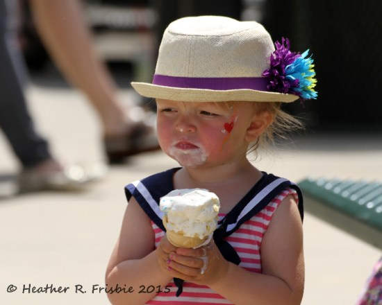 Enjoying an ice cream on the warm day - and serious about her ice cream!