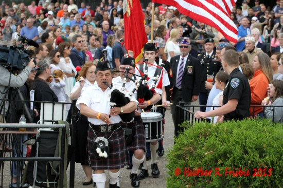 The pipe and drum corps lead the procession into the winners' circle.