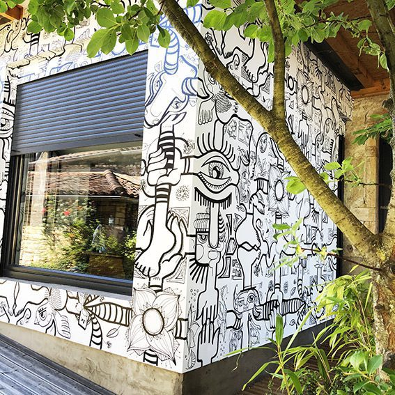 Giant black n white vinyle stickers give a mural graffiti on country side My Art Box showroom located in Viré 71260 France