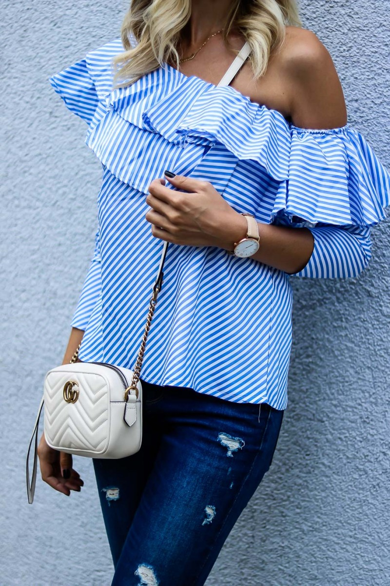 Light blue ruffled one-shoulder top Outfit with denim, pumps and white gucci marmont bag
