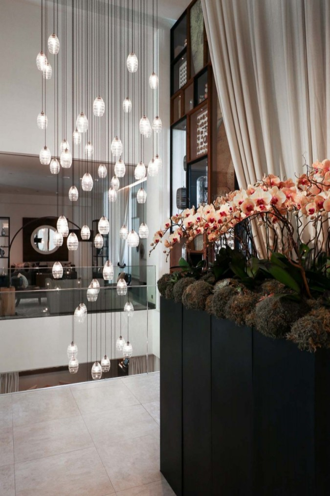 Vida Downtown Dubai lights and flowers in the lobby
