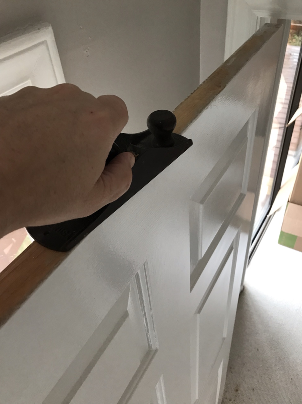 Long even strokes on planing a door