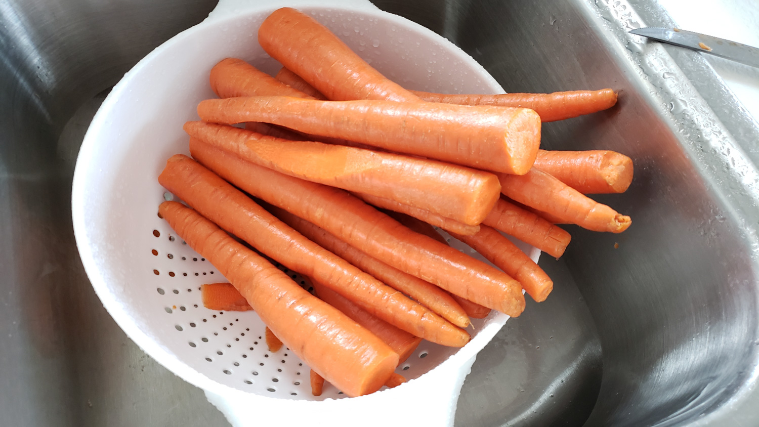 raw carrots getting cleaned