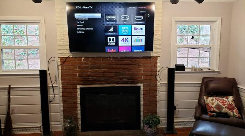 """mounted TCL 65"""" TV"""