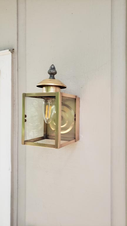 Cleaned and polished exterior lighting fixture