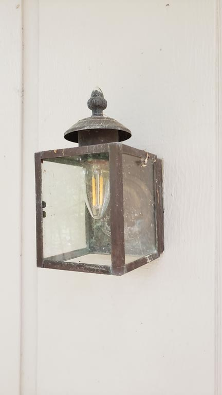 old dirty brass lighting fixture