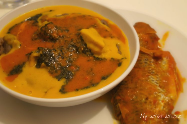 image of gbegiri in a white bowl served with fresh tilapia fish