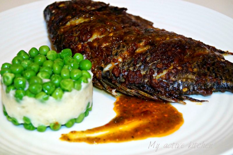 roasted harissa tilapia served with mashed yam and peas.