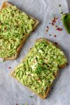 slices of avocado egg salad made with avocado, eggs, herbs, salt and pepper