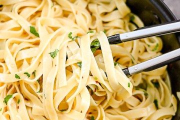 a close shot of tagliatelle in a pan