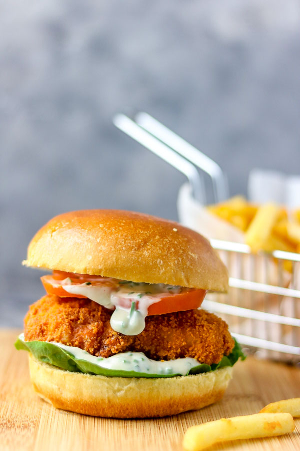 fish burger with chips on the side