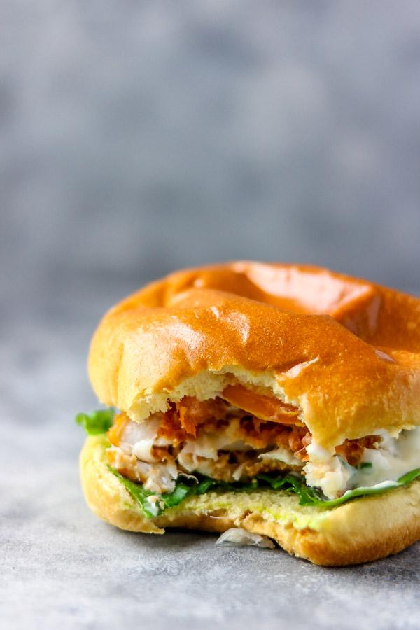 image of bite shot of crispy fish burger