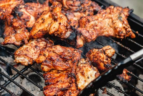 grilled boneless chicken thighs on a barbecue.