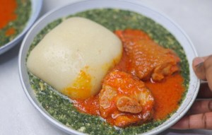 a plate of fufu and soup.