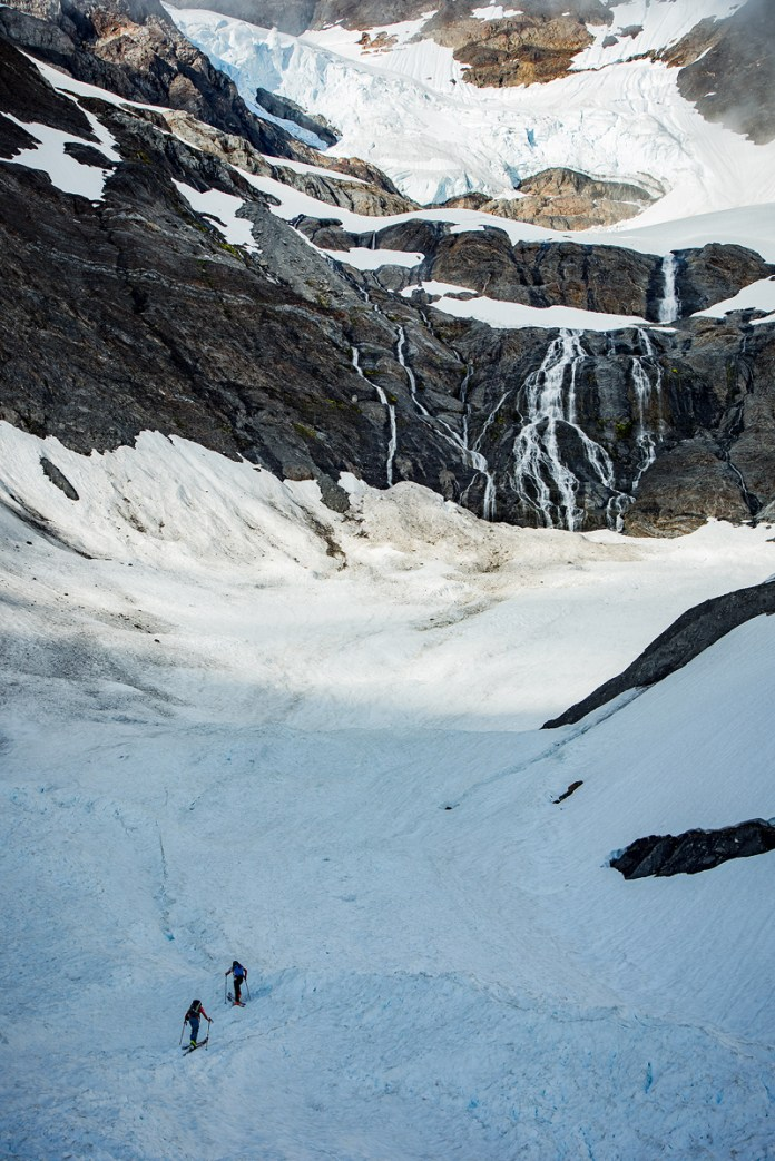 Jake and Carl beneath the Zephyros Glacier and waterfall.