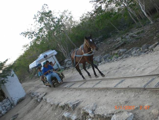 The cart that carries passengers to the cenotes