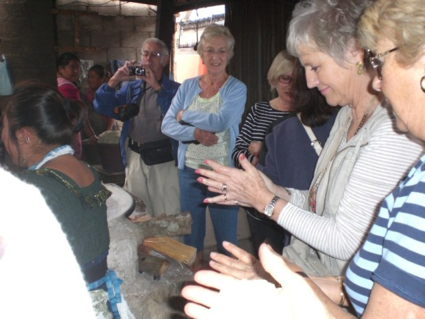 A good tour leader will make sure you help the local economy, even if it means making tortillas in Antigua